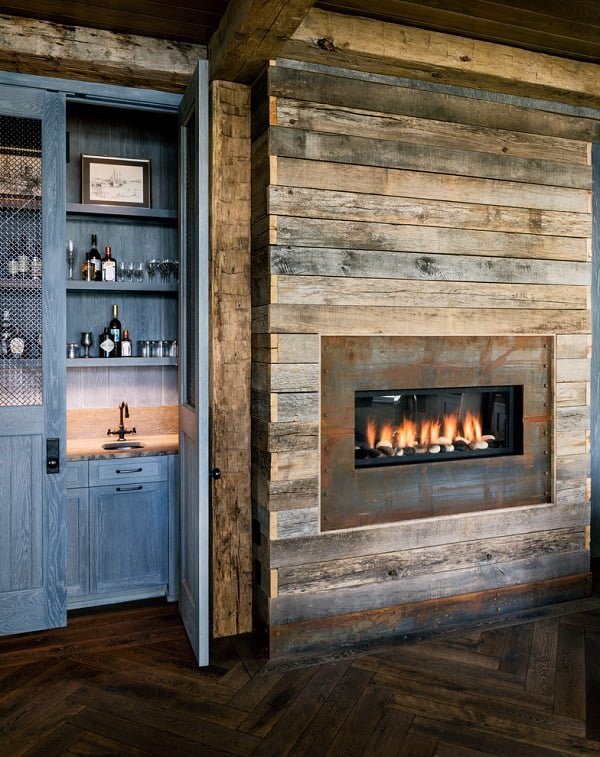 living room decor idea with built-in fireplace and secluded kitchen. Love it!