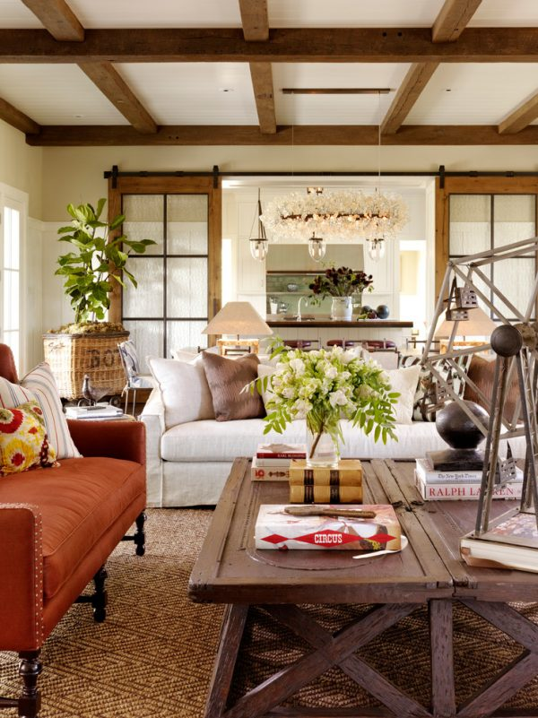 living room decor idea with a luxurious chandelier and lively floral arrangement! Love it!