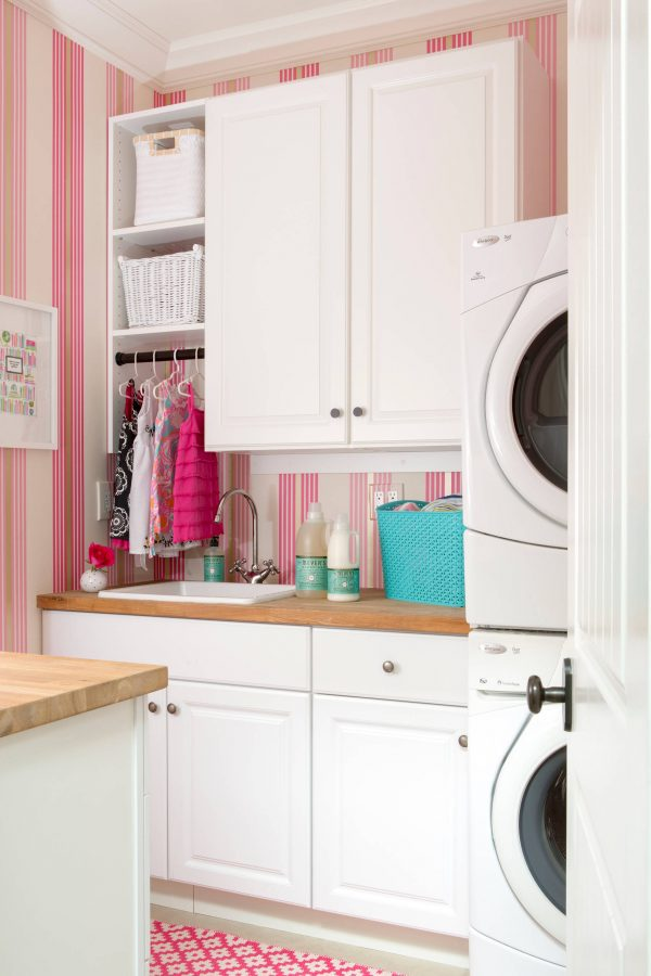 100 Fabulous Laundry Room Decor Ideas You Can Copy - You have to see this #laundryroom decor idea with wood countertops and layered washing machines. Love it! #LaundryRoomDecor #HomeDecorIdeas