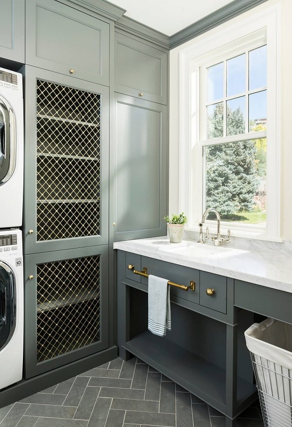 100 Fabulous Laundry Room Decor Ideas You Can Copy - You have to see this #laundryroom decor idea with shaker cabinets and a stacked washer-dryer combo. Love it! #LaundryRoomDecor #HomeDecorIdeas