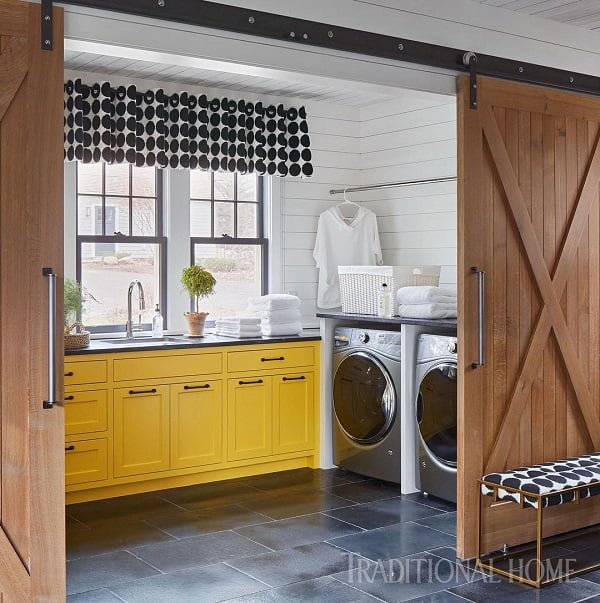 100 Fabulous Laundry Room Decor Ideas You Can Copy - You have to see this #laundryroom decor idea with bright yellow cabinets and innovative metalic washing machines. Love it! #LaundryRoomDecor #HomeDecorIdeas