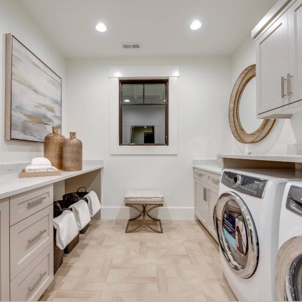 100 Fabulous Laundry Room Decor Ideas You Can Copy - You have to see this #laundryroom decor idea with minimalistic furnishing and a retro, inside window. Love it! #LaundryRoomDecor #HomeDecorIdeas
