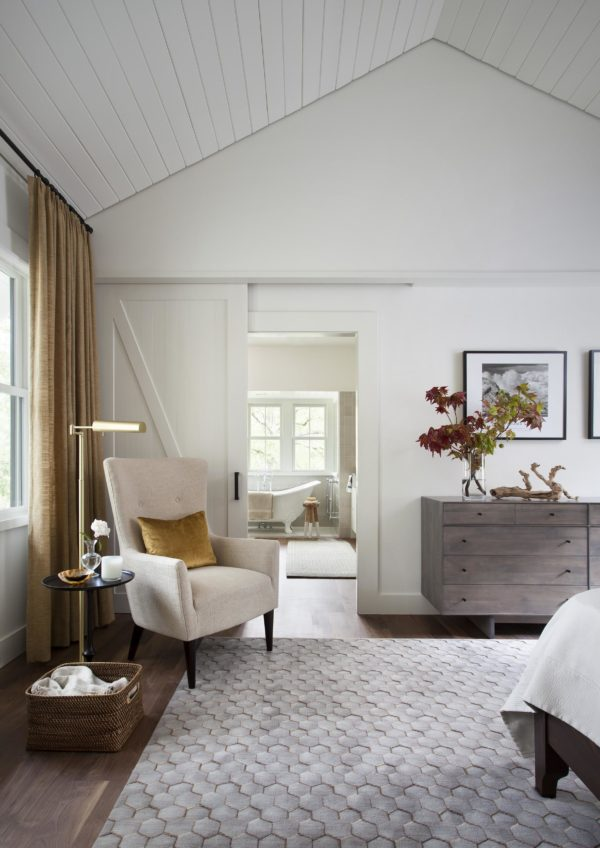 You have to see this #modernfarmhouse decor idea with patterned neutral carpet and a white sliding barn door. Love it! #ModernFarmhouseDecor #HomeDecorIdeas