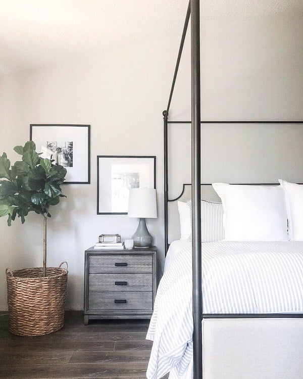 You have to see this #modernfarmhouse decor idea with two framed paintings and soft, white bedding. Love it! #ModernFarmhouseDecor #HomeDecorIdeas