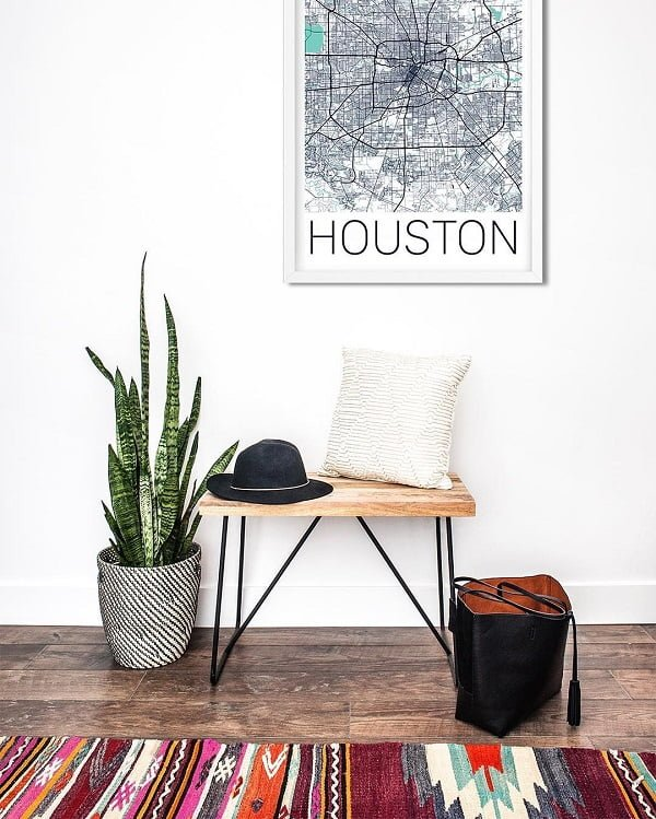 You have to see this #modernfarmhouse decor idea with hardwood floors, a white patterned pillow and plain white walls. Love it! #ModernFarmhouseDecor #HomeDecorIdeas
