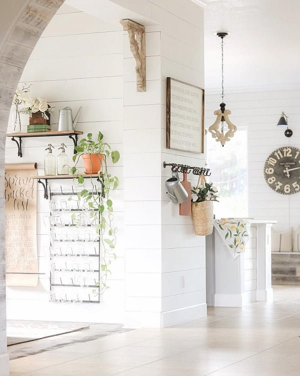 You have to see this #modernfarmhouse decor idea with chain-hanging ceiling lamp and white smooth floors. Love it! #ModernFarmhouseDecor #HomeDecorIdeas