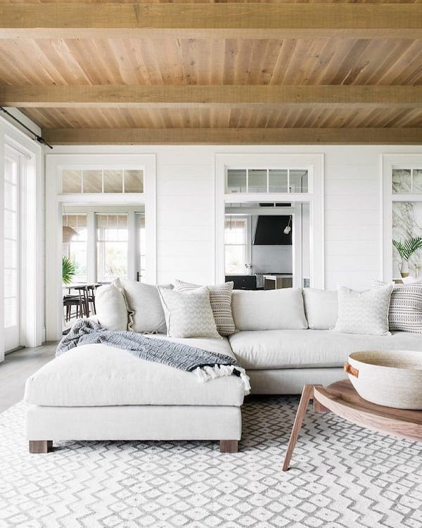 You have to see this #modernfarmhouse decor idea with ceramic fruit and storage bowl and hadrwood ceilings. Love it! #ModernFarmhouseDecor #HomeDecorIdeas
