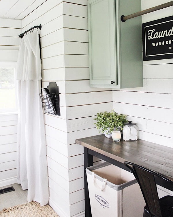 You have to see this #modernfarmhouse decor idea with a single hanging cabinet and large laundry basket. Love it! #ModernFarmhouseDecor #HomeDecorIdeas