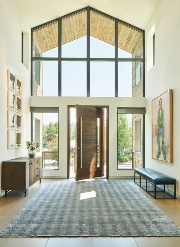 You have to see this #modernfarmhouse decor idea with double-layered windows and brown wood entrance door. Love it! #ModernFarmhouseDecor #HomeDecorIdeas