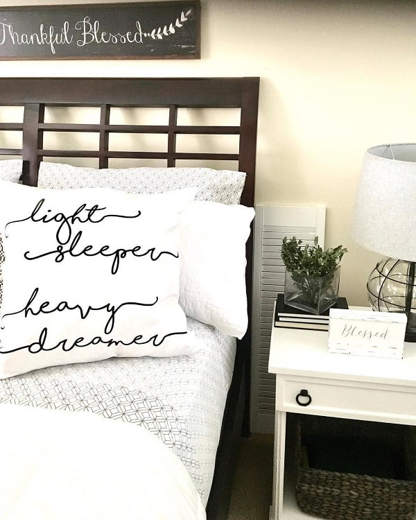 You have to see this #modernfarmhouse decor idea withall-white nightstand and functional semi-glass nightlamp. Love it! #ModernFarmhouseDecor #HomeDecorIdeas