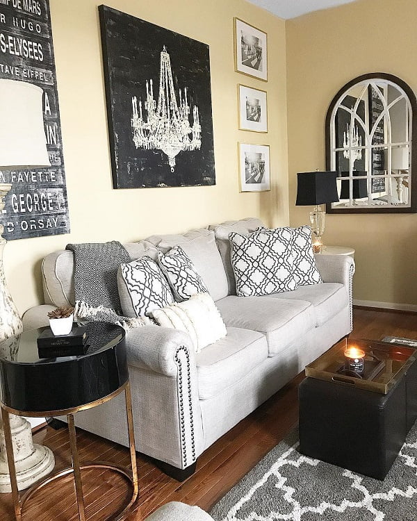 decor idea with ottoman coffee table and expensive-looking nightstand. Love it!