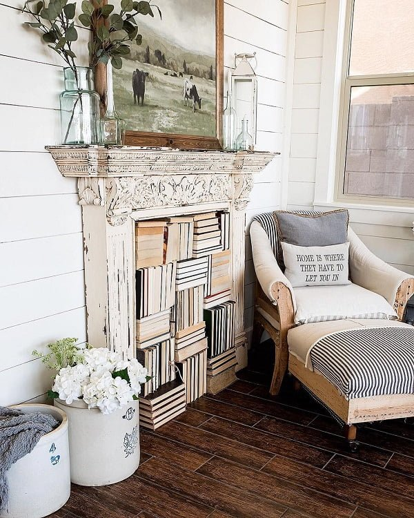 decor idea with dark plank floor and dramatic over-the-fireplace painting. Love it!