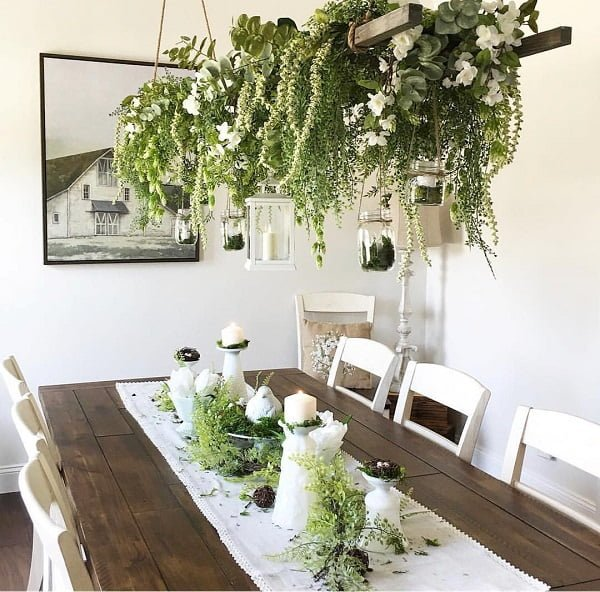 #modernfarmhouse decor idea with hanging mason jars and lanterns and all-wood dining room table set. Love it! #ModernFarmhouseDecor #HomeDecorIdeas