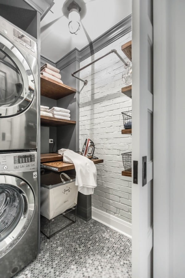 100 Fabulous Laundry Room Decor Ideas You Can Copy - You have to see this industrial laundry room decor idea with exposed brick wall. Love it! #HomeDecorIdeas #LaundryRoomDesign