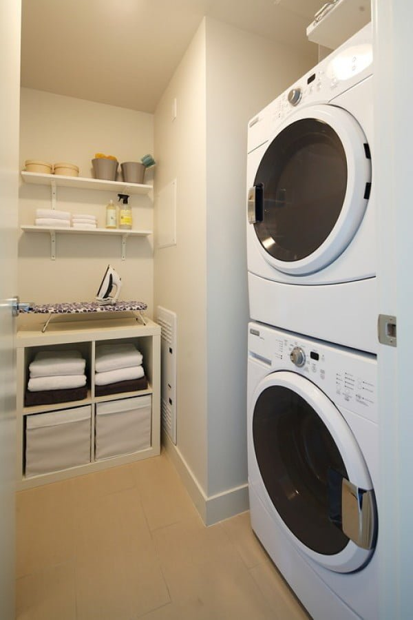 100 Fabulous Laundry Room Decor Ideas You Can Copy - You have to see this tiny laundry room decor idea with storage. Love it! #HomeDecorIdeas #LaundryRoomDesign