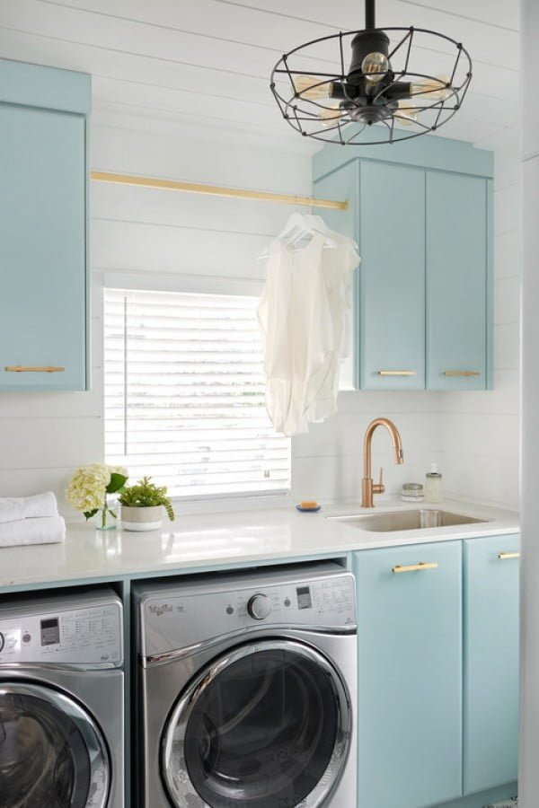100 Fabulous Laundry Room Decor Ideas You Can Copy - You have to see this laundry room decor idea with turquoise cabinets and shiplap walls. Love it! #HomeDecorIdeas #LaundryRoomDesign