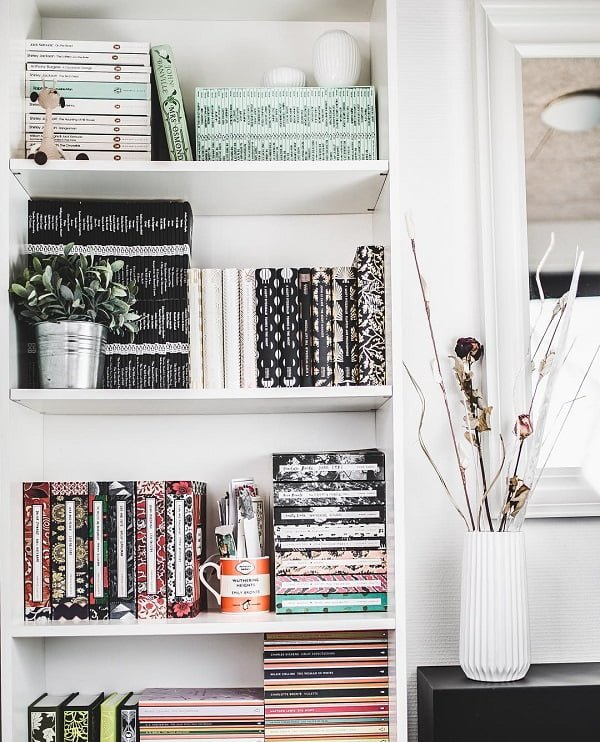 You have to see this #bookshelf decor idea with rectangular white box shelves and black, white and red book collections. Love it! #BookshelfDecor #HomeDecorIdeas