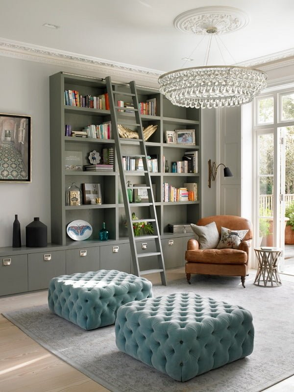 You have to see this #bookshelf decor idea with high hardwood ladder and an extended bottom cabinet segment. Love it! #BookshelfDecor #HomeDecorIdeas