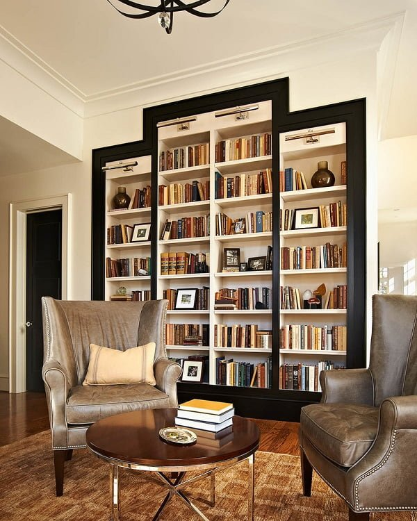 You have to see this #bookshelf decor idea with black hardwood bookshelf frame and gold ceiling lights. Love it! #BookshelfDecor #HomeDecorIdeas