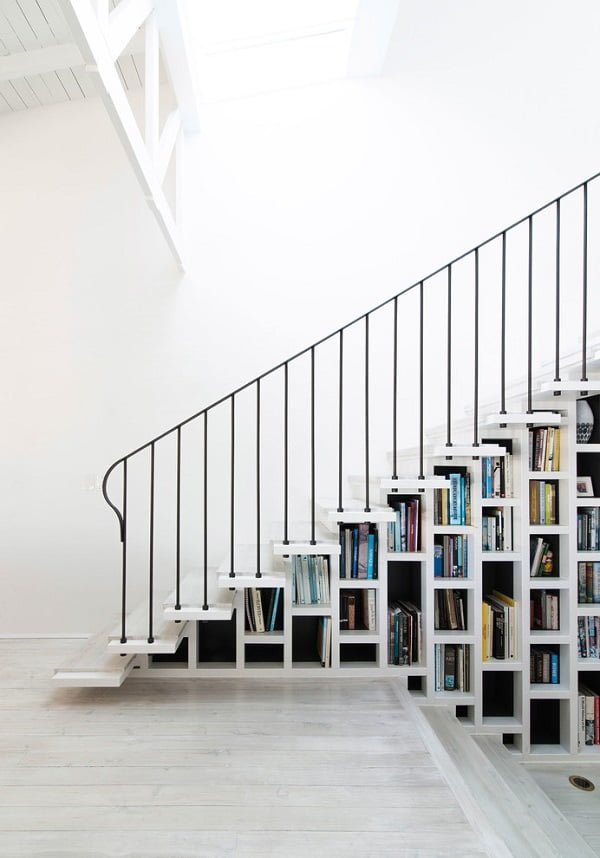 You have to see this #bookshelf decor idea with narrow white box shelves in different sizes. Love it! #BookshelfDecor #HomeDecorIdeas
