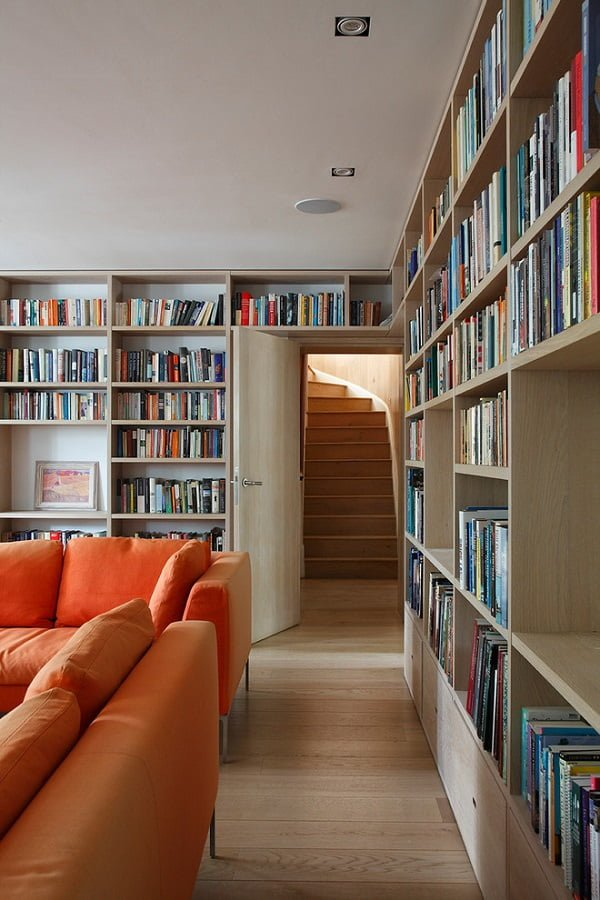 You have to see this #bookshelf decor idea with cream hardwood planks and above-the-door shelves as well. Love it! #BookshelfDecor #HomeDecorIdeas