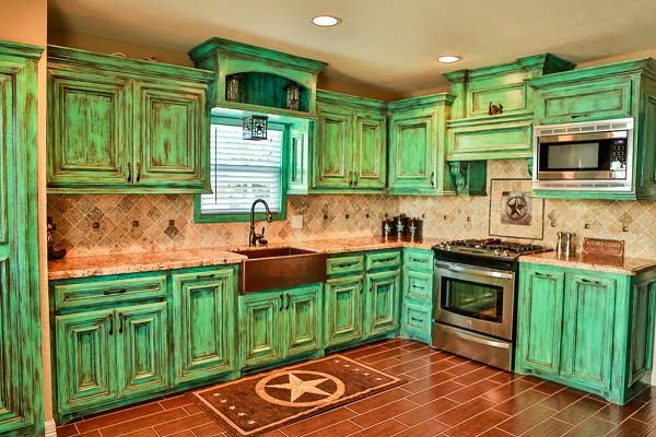 Green weathered rustic kitchen cabinets