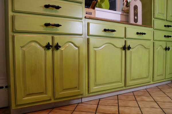 Painted green rustic kitchen cabinets