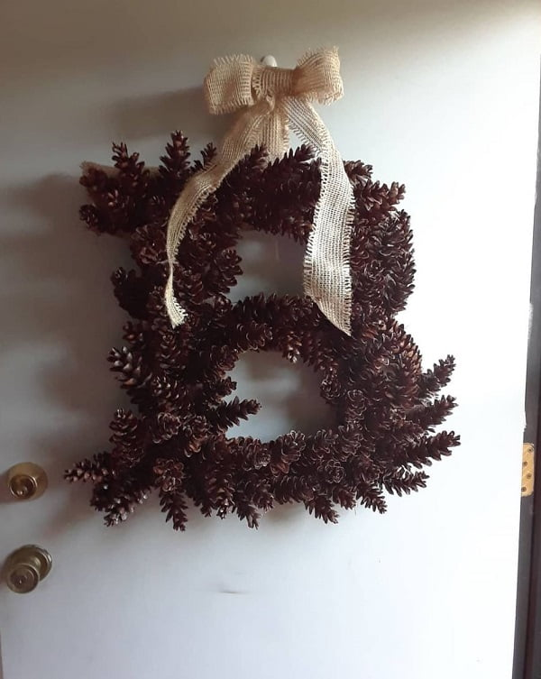 Pinecone monogram wreath front door decor idea