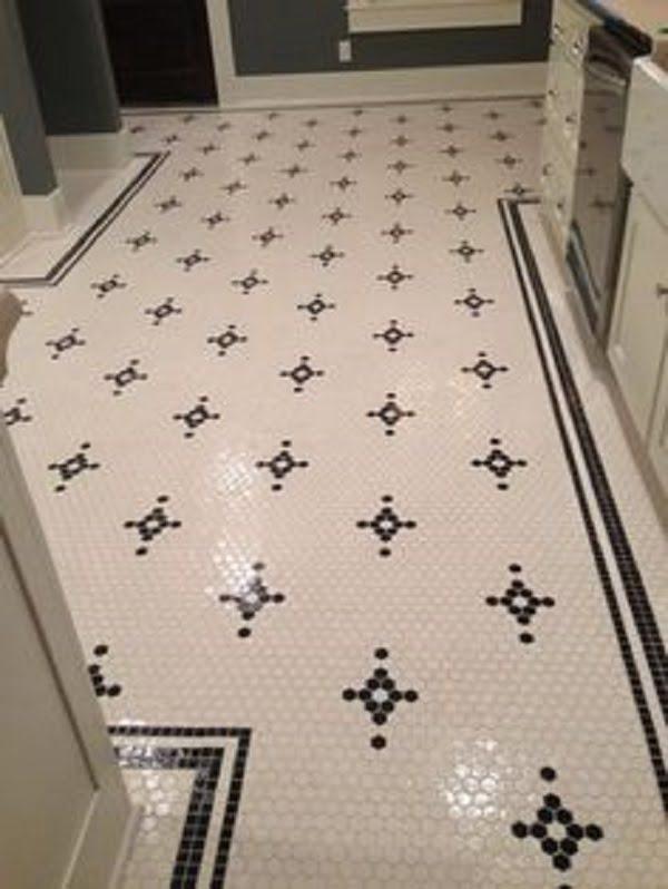 Floral motif kitchen floor tile idea