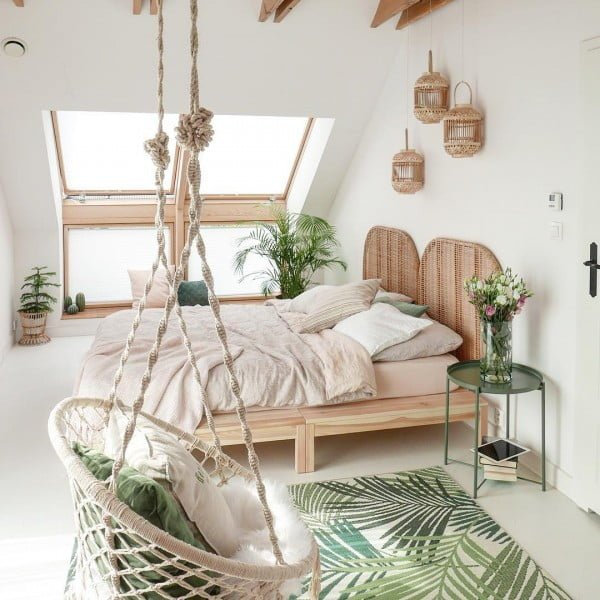 Hanging macrame chair in boho bedroom