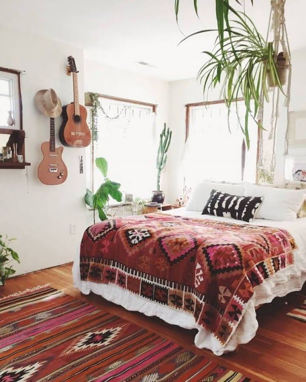Hanging plants and musical instruments boho bedroom