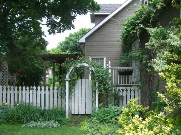 Weathered Picket Garden Fence with an Arch #garden