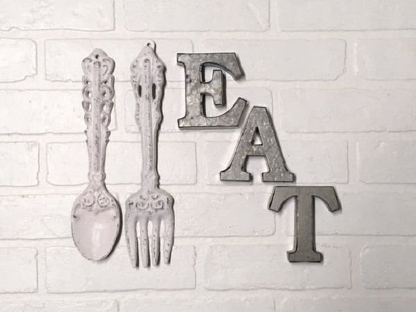 Letter sign and giant utensil kitchen wall art idea