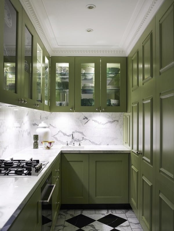 Lime green kitchen cabinets against marble