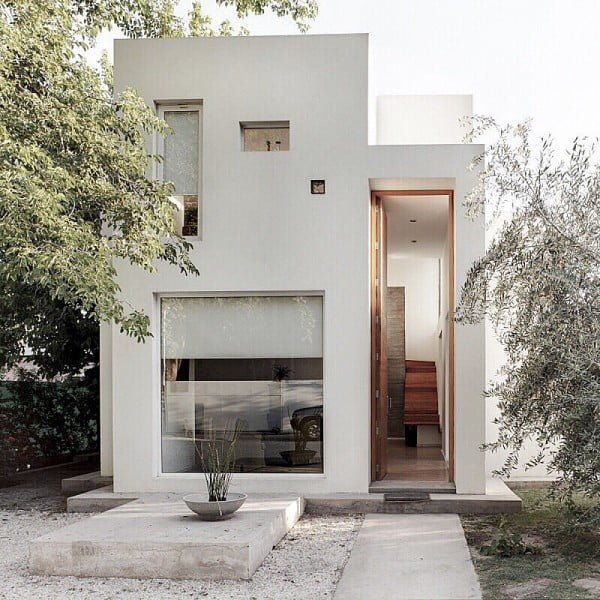 Minimalist House with Unusually Tall Door
