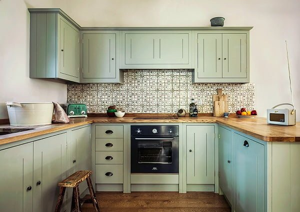 Mint green kitchen cabinets and butcher block countertops #kitchendecor