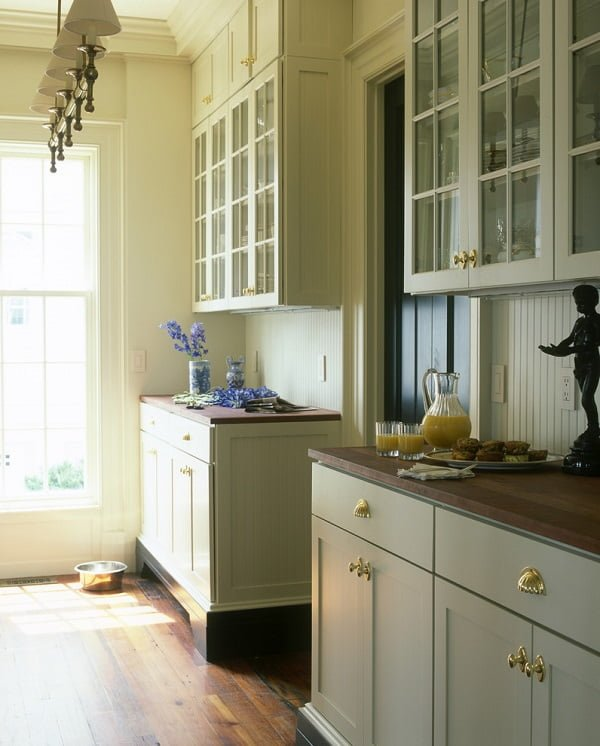 Subtle soft green kitchen cabinets