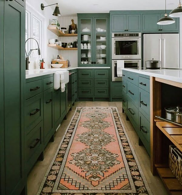 Teal green kitchen cabinets and an accent runner rug #homedecor