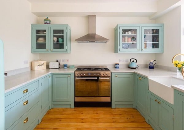 Turquoise shaker cabinets in a farmhouse kitchen