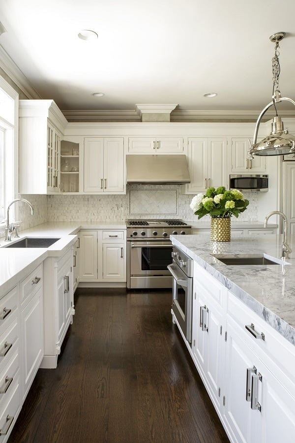 White Kitchen Cabinets with Marble Tile Backsplash and Dark Wood Floor #kitchendesign