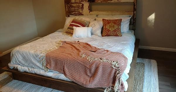 DIY platform bed with an upcycled door for a headboard