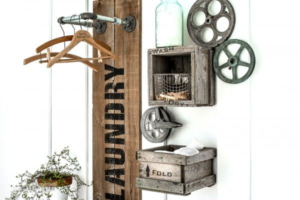 reclaimed wood and pipe LAUNDRY sign hanging station    working