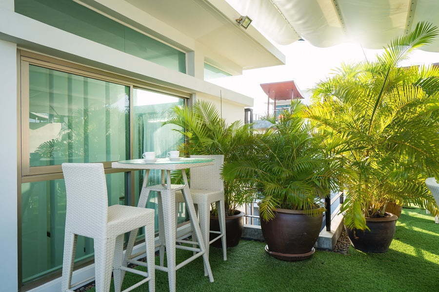 apartment patio with potted plants