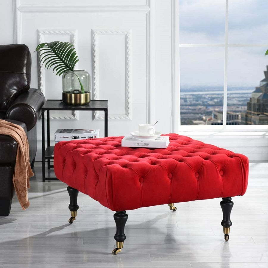 red tufted ottoman on caters