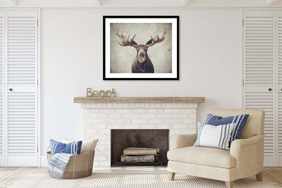 poster over fireplace